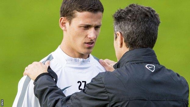 Celtic midfielder Aleksandar Tonev and assistant manager John Collins