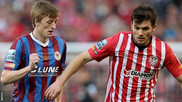Christopher Forrester of St Pat's in action against Derry City's Philip Lowry