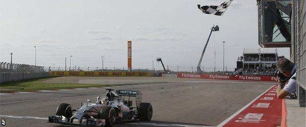 Lewis Hamilton crosses the line to win the US Grand Prix