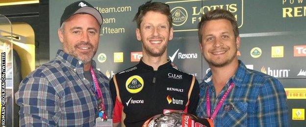 Lotus driver Romain Grosjean tweets a picture of him presenting Matt Le Blanc (left) with a helmet