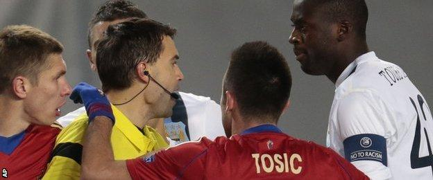 Manchester City's Yaya Toure (r) speaks to the referee Ovidiu Hategan (l) during the Champions League match between CSKA Moscow and Manchester City
