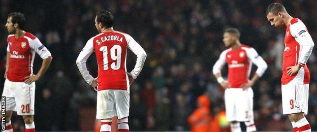 Arsenal players react to their 3-3 draw with Anderlecht