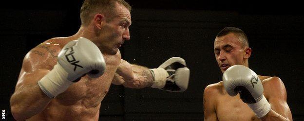 Scott Harrison against Gyorgy Mizsei Jnr (right)