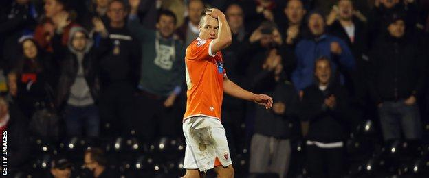 Tony McMahon walks off the pitch after being sent off at Fulham