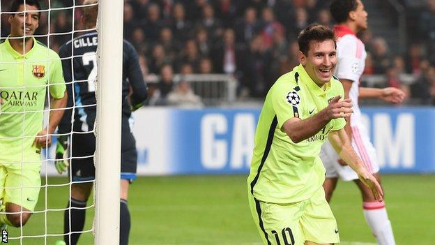 Lionel Messi celebrates scoring for Barcelona against Ajax in the Champions League