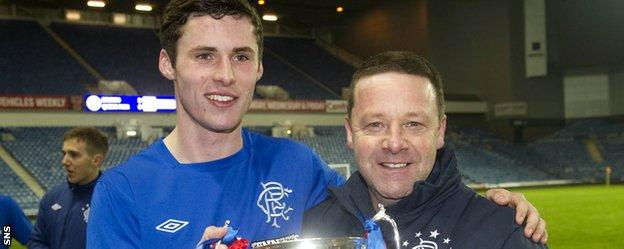 Tommy Wilson with Jordan Wilson after Rangers won the reserve league title in 2013