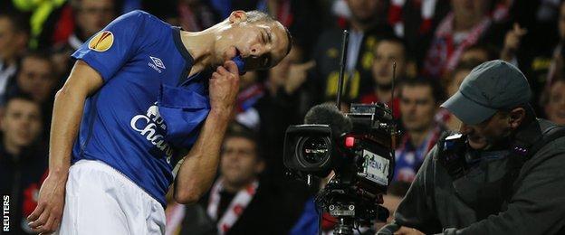 Leon Osman celebrates scoring Everton's first goal against Lille in the Europa League