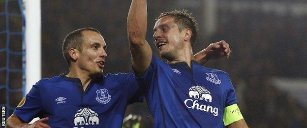 Phil Jagielka celebrates scoring Everton's second goal in a 3-0 win over Lille in the Europa League