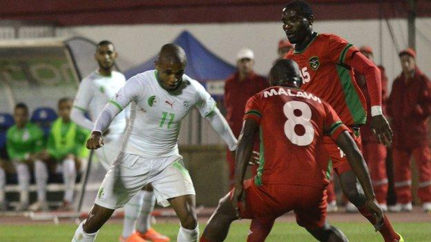 Malawi in action against Algeria