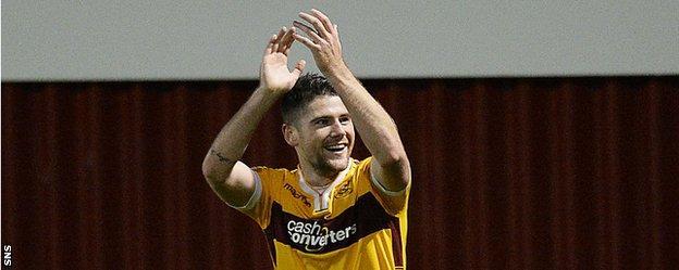Motherwell midfielder Iain Vigurs celebrates