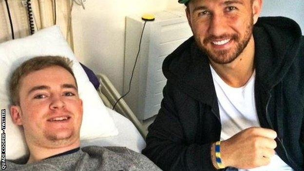 Australia fly-half Quade Cooper (right) has also donated a signed shirt to Owen Williams as he continues his recovery