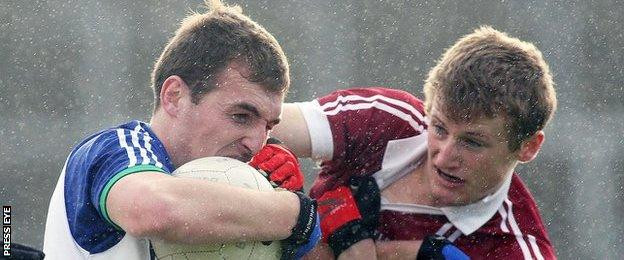 Slaughtneil's Brendan Rogers [right] battles with Ballinderry's Ryan Bell in the Derry Final