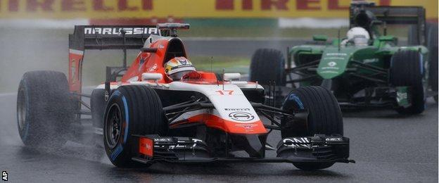 Marussia driver Jules Bianchi of France leads Caterham driver Kamui Kobayashi of Japan during the Japanese Formula One Grand Prix.