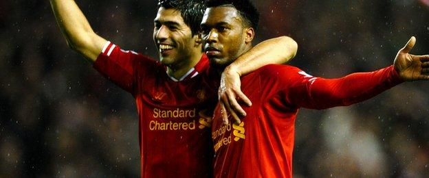 Daniel Sturridge (right) is congratulated by former teammate Luis Suarez after scoring a goal