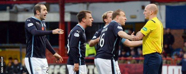 Dundee players were appalled when Clarkson was booked for diving