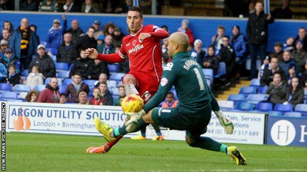 Birmingham goalkeeper Darren Rudolph saves from Adam Le Fondre
