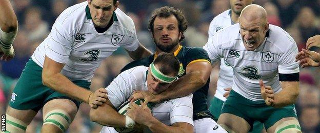 Rhys Ruddock is tackled by Bismarck du Plessis
