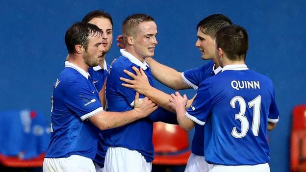 Aaron Burns is congratulated after scoring one of his two goals in Linfield's 4-0 win over Dungannon Swifts