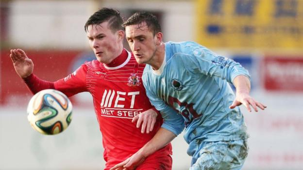 Peter McMahon and Stephen O'Donnell keep their eyes on the ball during Portadown's win over Institute