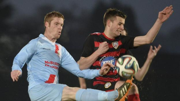 Darren Boyce and Ian Parkhill contend for the ball in the second half of Coleraine's 2-0 victory at the Showgrounds