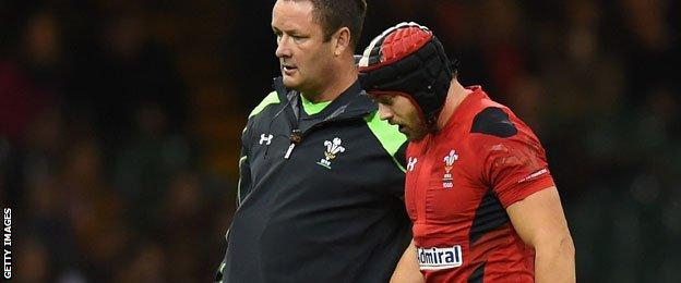 Leigh Halfpenny is led off the field against Australia.