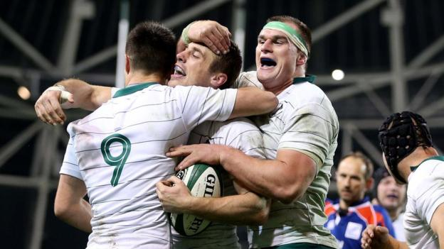 Conor Murray and Rhys Ruddock congratulate Tommy Bowe after the winger scores Ireland's second try