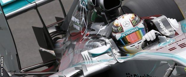 """Mercedes"""" British Lewis Hamilton powers his car during the qualifying round at the Interlagos racetrack in Sao Paulo, Brazil on November 8, 2014 on the eve of the Brazil Formula One Grand Prix."""
