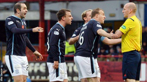 Dundee players take issue with referee Bobby Madden