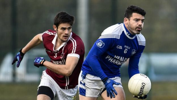Christopher McKaigue prepares to challenge Eamonn Reilly as Slaughtneil run out 0-11 to 0-9 winners over Cavan Gaels