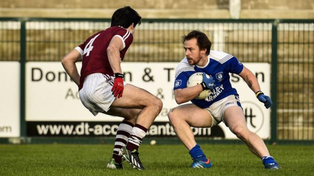 Karl McKaigue closes in on Sean Johnston during Sunday's semi-final encounter between the Derry and Cavan champions