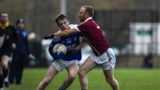 Vincent Coyle and Conan Cassidy vie for possession in a keenly fought last four tie
