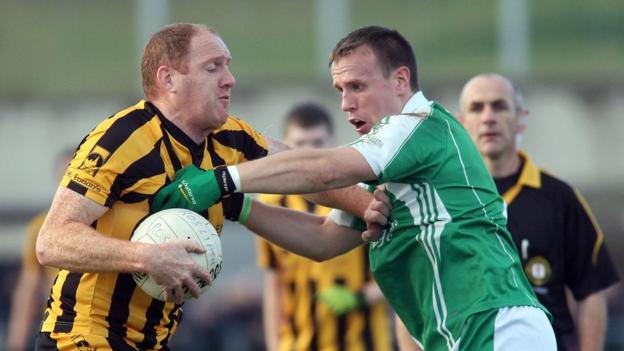 John Haran is challenged by Peter Lynch as St Eunan's book a semi-final place against Omagh