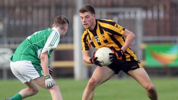Sean McVeigh shields the ball from Martin Beagan as St Eunan's defeat Roslea by six points