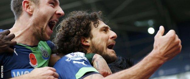 Coloccini celebrates his goal against West Brom
