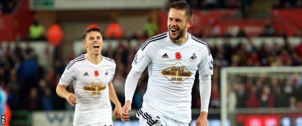 Gylfi Sigurdsson celebrates his goal for Swansea against Arsenal