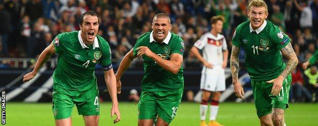 John O'Shea of the Republic of Ireland (left) celebrates scoring a stoppage time equaliser in Germany