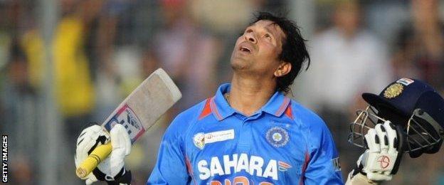 Sachin Tendulkar celebrates scoring his 100th international century