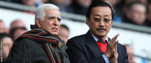 Sam Hammam (left) became life president at Cardiff City as part of the deal with current owner Vincent Tan to pay off debts
