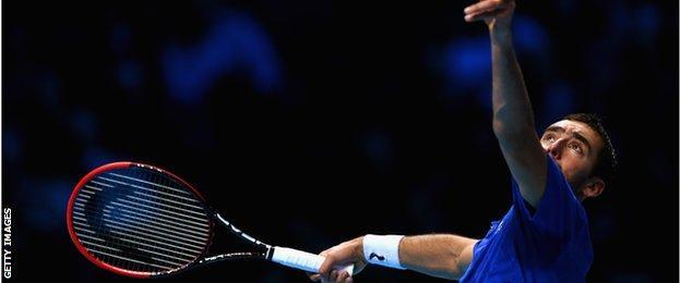 Marin Cilic serves against Tomas Berdych