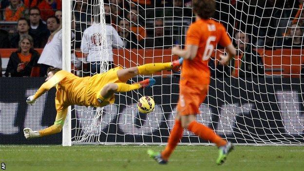 Netherlands goalkeeper Tim Krul is beaten by Carlos Vela's curling shot