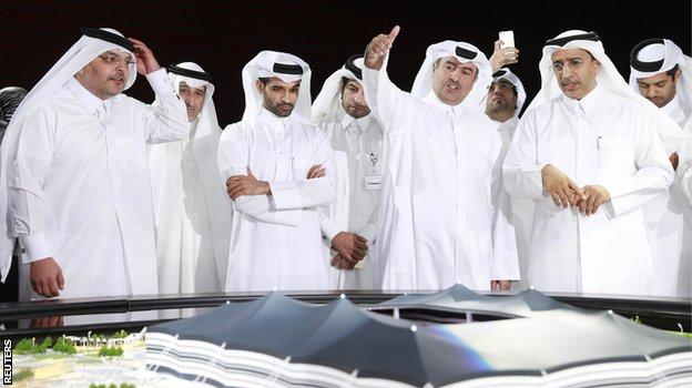 Hassan Al-Thawadi (third left) speaks during a news conference to announce the start of work on the Al-Khor Stadium in Al-Khor