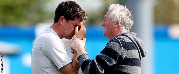 Darrell Clarke comforted by Bristol Rovers fan after relegation