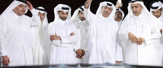 Hassan Al Thawadi (third left) says Qatar is happy to stage the World Cup at any time of year
