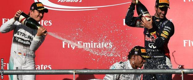 Lewis Hamilton of Britain (C) sprays champagne on the podium after winning the United States Formula One Grand Prix at the Circuit of The Americas in Austin, Texas on November 2, 2014.