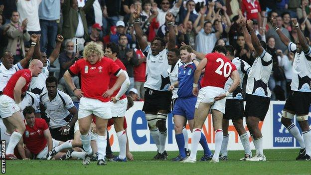 Fiji players celebrate their 38-34 win over Wales at the 2007 World Cup