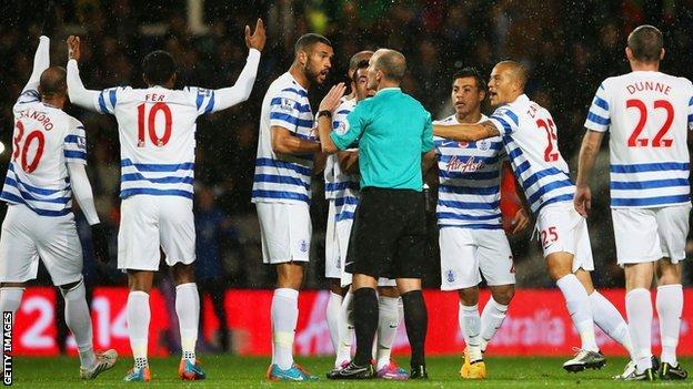 QPR players protest at Mike Dean's decision