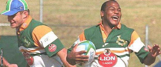 Chester Williams (right) shares a joke with captain Francois Pienaar during the 1995 World Cup