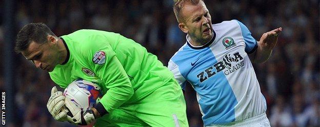 David Marshall saves while challenged by Blackburn's Scotland striker, Jordan Rhodes