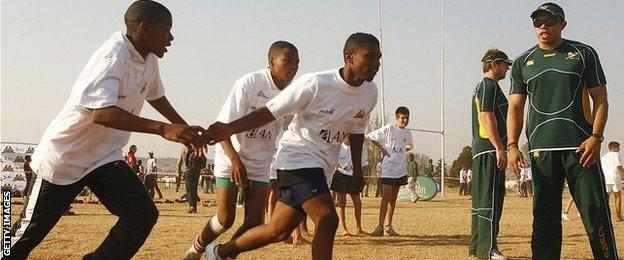 Springboks wing Bryan Habana (right) takes a coaching clinic in Soweto in 2008