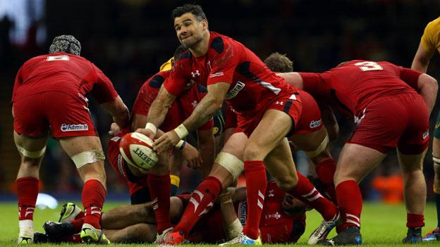 Mike Phillips passes the ball from the base of a scrum